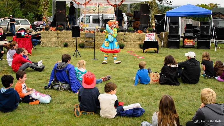 kids watching clown perform