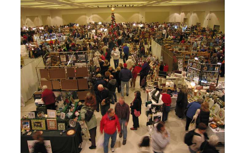 large crowd at a holiday marketplace