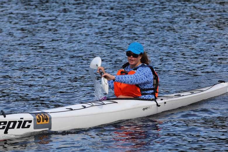 woman in boat in water