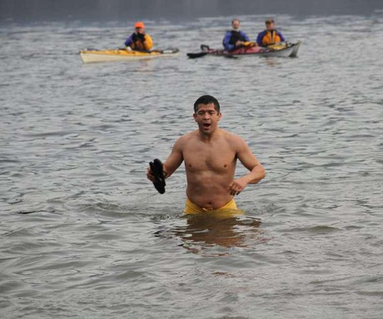 photo of man in lake during polar plunge