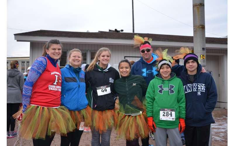 runners dressed in turkey-themed outfits for a race