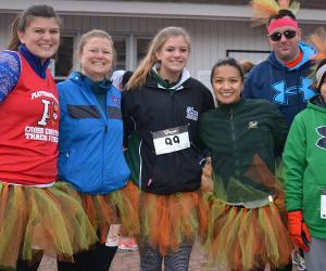 people dressed for turkey trot
