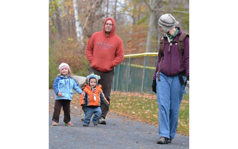family walking outside at camp chingachgook in the fall