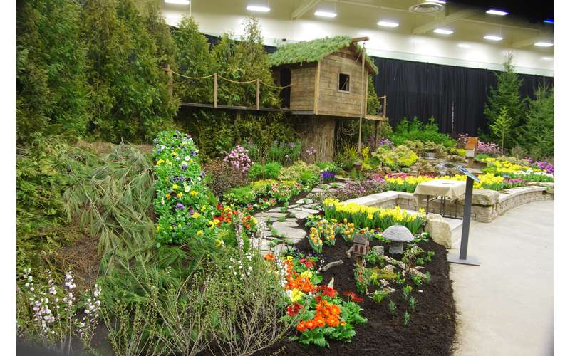 greenery display complete with a wooden treehouse