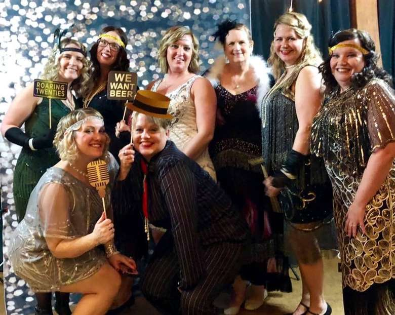 mom prom attendees dressed in a roaring 20s theme