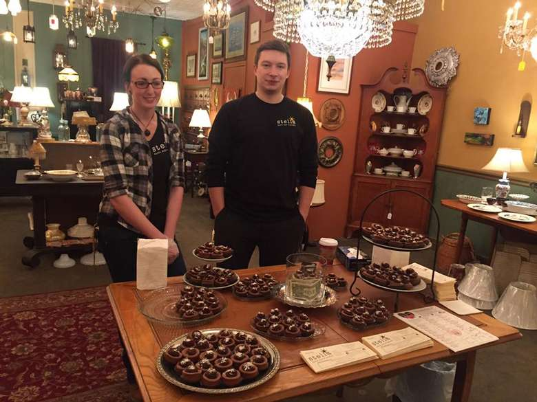 man and woman near chocolate samples