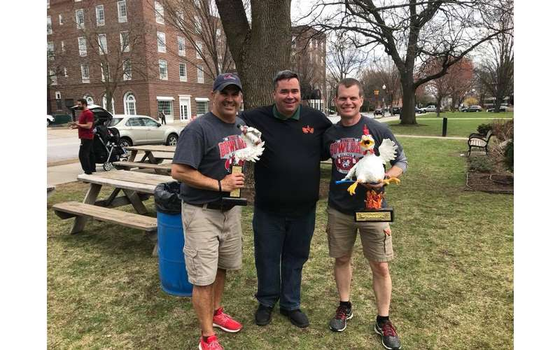 three people with wingfest trophy