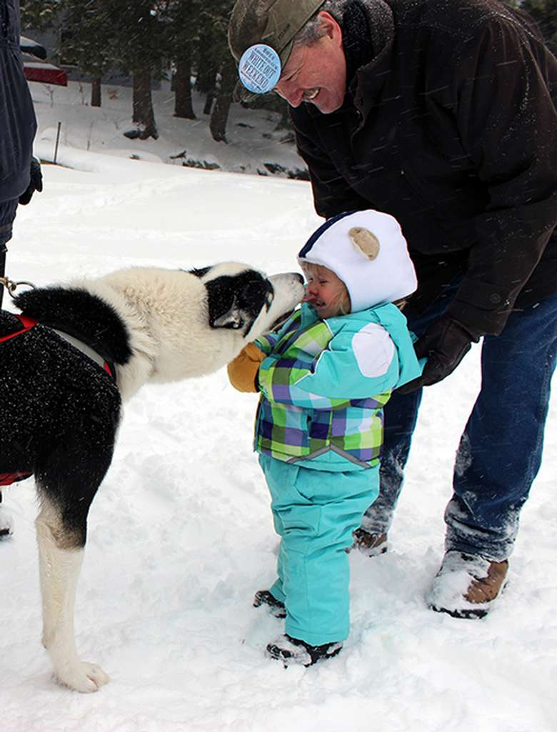 girl in winter outfit with a dog
