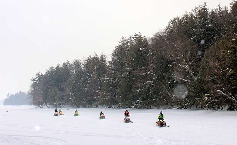 snowmobiling near forest