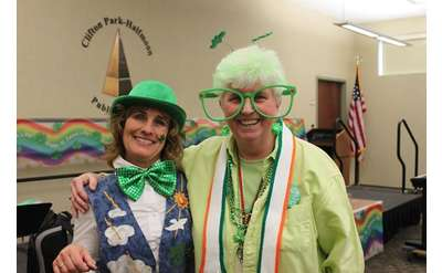 two people in st patrick's outfits