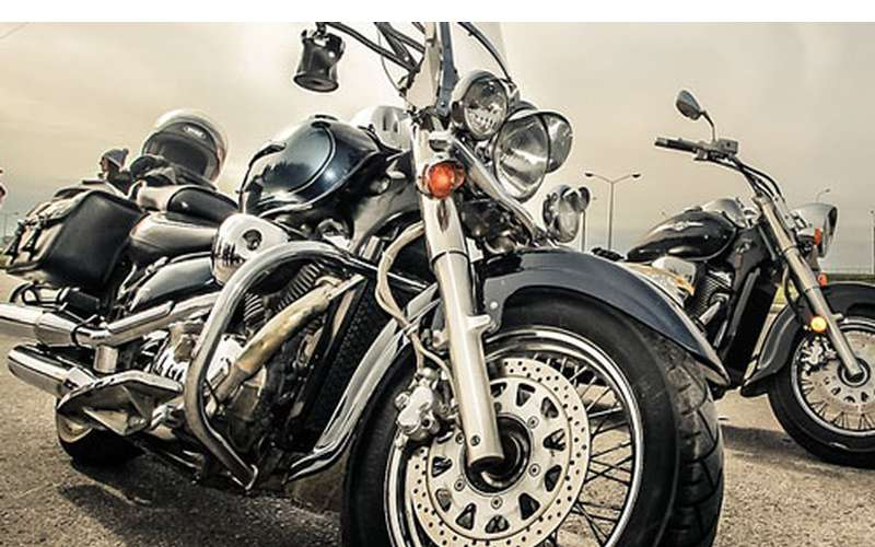 up close look at two black motorcycles