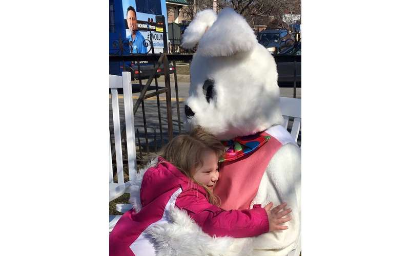 a young girl hugging the easter bunny