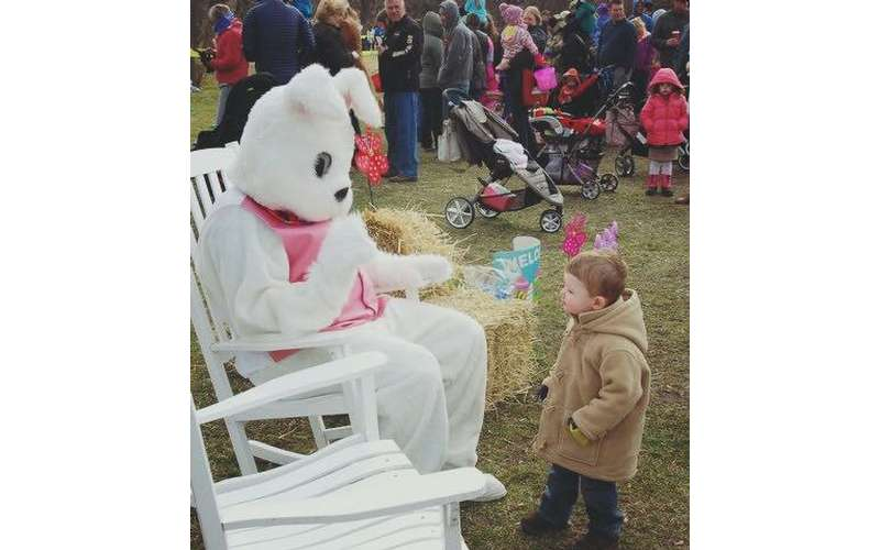easter bunny greeting a boy at an oudoor event