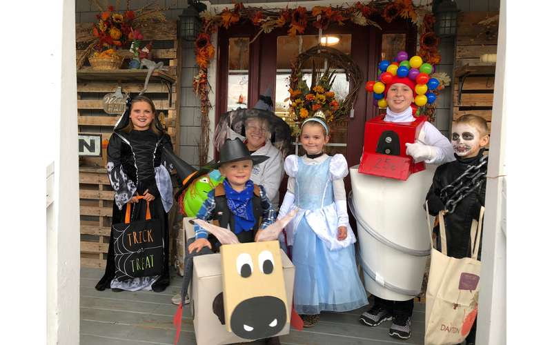 five kids dressed in halloween costumes