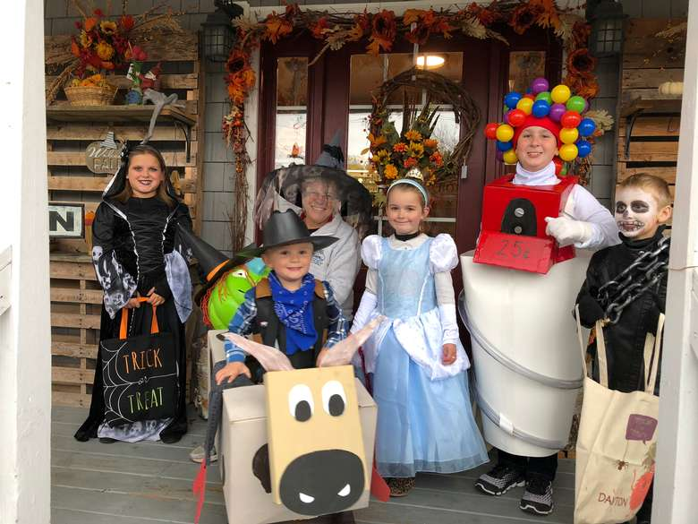 five kids dressed in halloween costumes