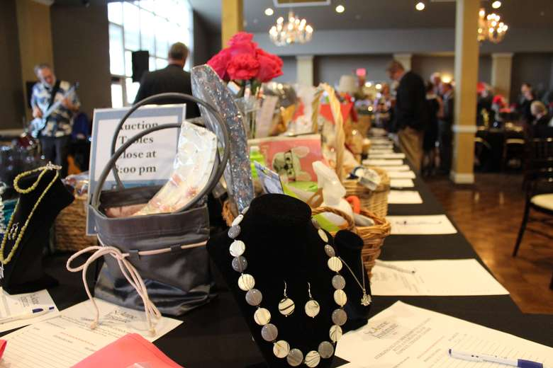 silent auction items on a table
