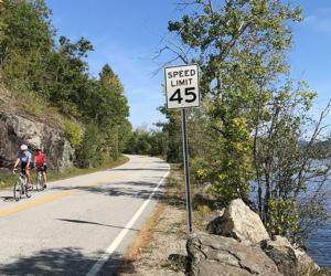 people biking next to brant lake