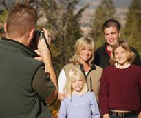 a photographer shooting a family