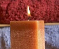 a lit brownish orange candle