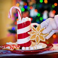 Santa's arm grabbing a cookie