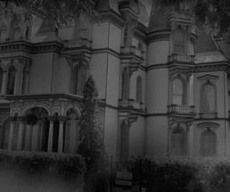 a spooky mansion in a black and white photo