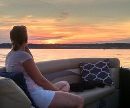 woman on boat in saratoga lake