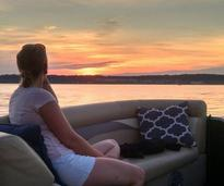 woman on boat in saratoga lake