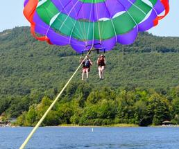 couple parasailing over lake
