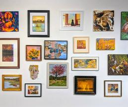 paintings and art on wall