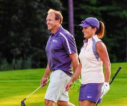 couple on golf course smiling