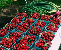 cherries on display at farmers market
