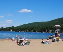 people at million dollar beach on lake george