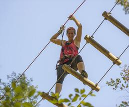 woman on a ropes course