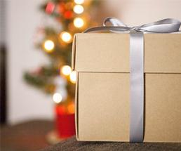 a brown gift box with a silver ribbon