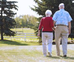 senior citizens holding hands