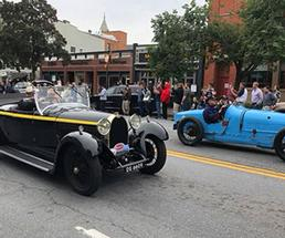 antique cars on road