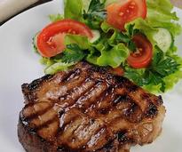 Grilled chop with a salad