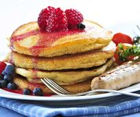 Pancakes, berries and sausages