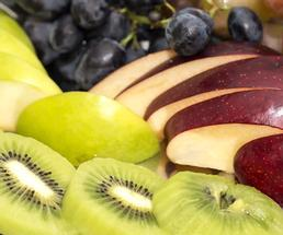 sliced fruit like kiwi and apples