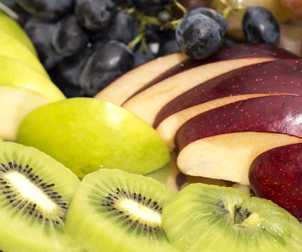 sliced fruit like kiwi and apples