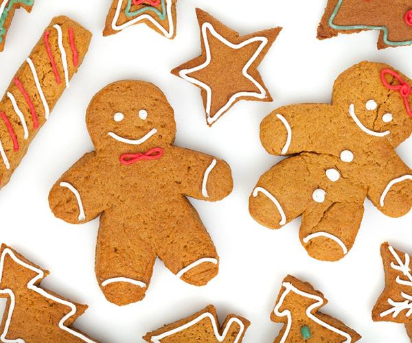 gingerbread cookies in the shape of trees, stars, and gingerbread men