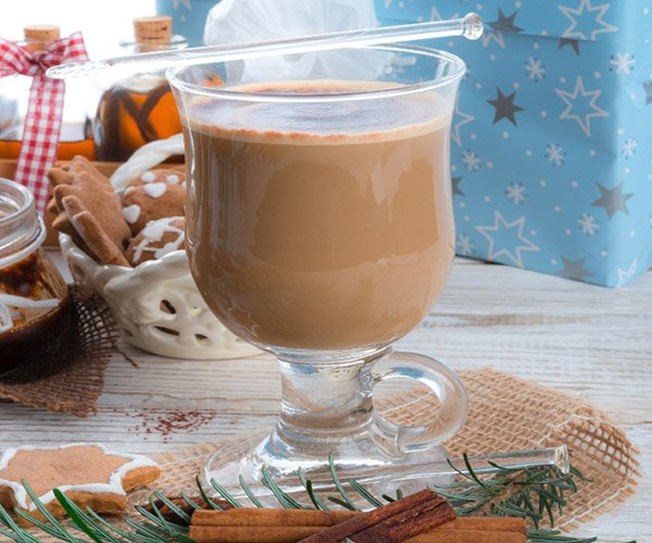 a glass of brown holiday eggnog
