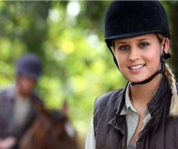woman in an equestrian outfit