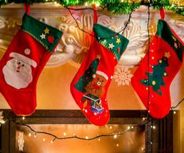 three red decorated christmas stockings