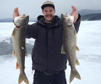 holding up catch from ice fishing
