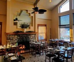 fire in fireplace in dining room