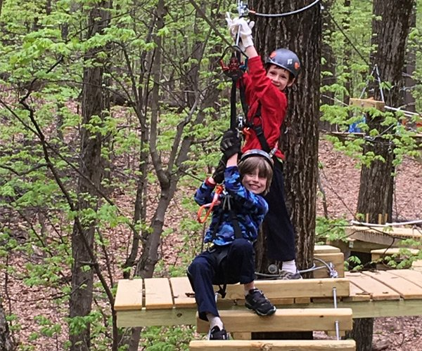 two boys on a ropes course