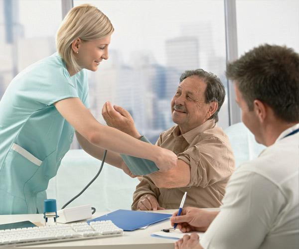 nurse taking man's blood pressure