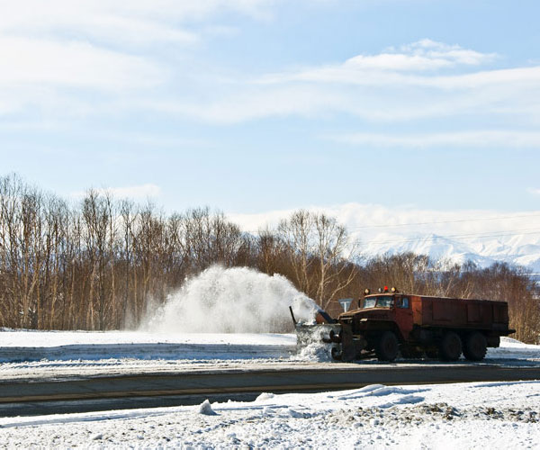 snow plow clearing highway