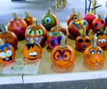 painted pumpkins on a table for sale